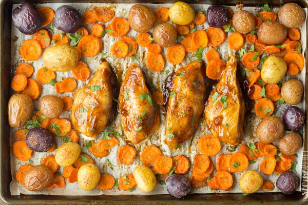 A sheet pan recipe of apricot chicken and potatoes