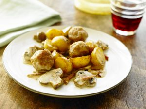 Pork meatball casserole with potatoes and mushrooms.