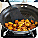 Shows the last step of cooking instructions, potatoes being flipped in pan once friend and cripsy