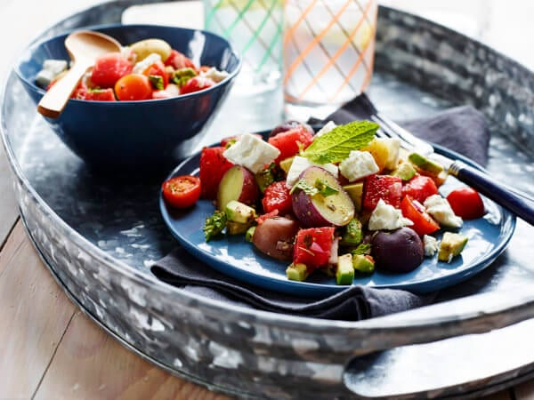 A colorful summer salad with watermelon, Creamer potatoes, and feta.