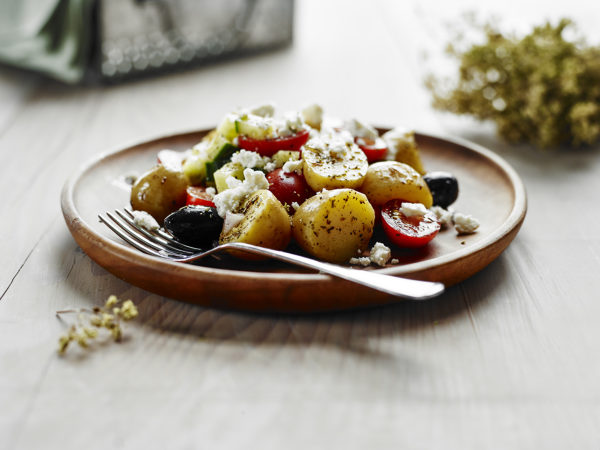 A plate of potato salad inspired by Greek cuisine.