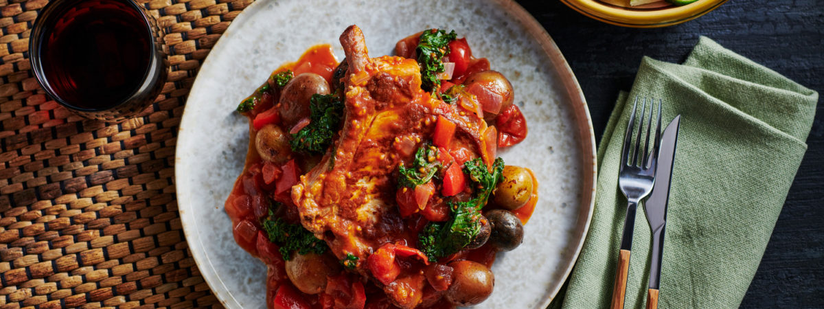 Pork Chops and Potatoes in Tomato Pepper Sauce